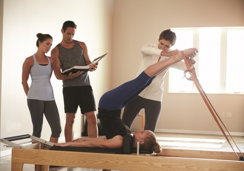 teacher and students on reformer